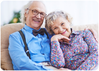 a senior couple smiling