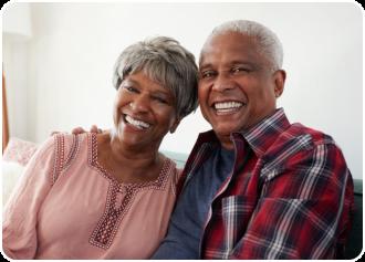 two African-American seniors smiling