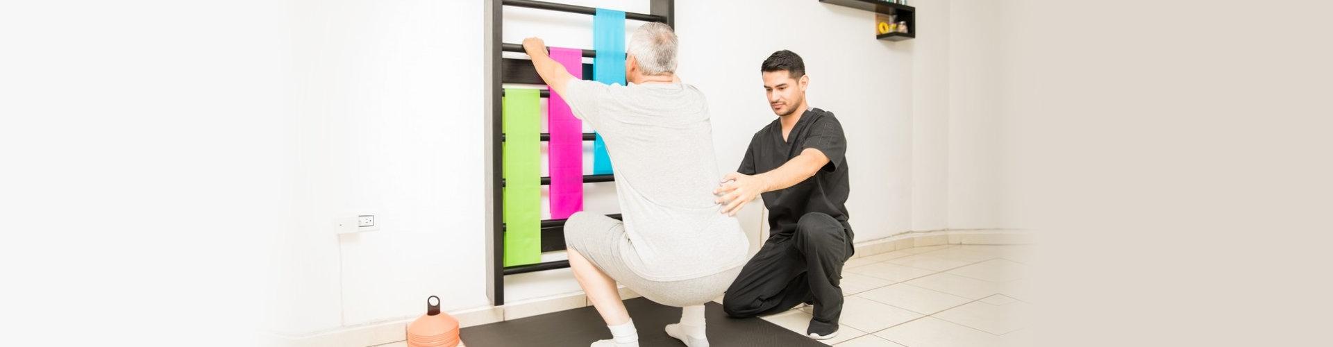 a caregiver assisting a senior man exercise